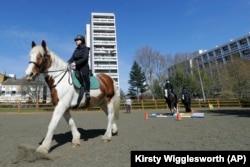 Manuela Jimenez, 15, rides Splash in a riding lesson at Ebony Horse Club in Brixton, London, April 18, 2021. (AP Photo/Kirsty Wigglesworth)