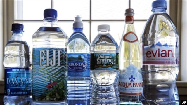 A selection of bottled waters stands on a kitchen counter in East Derry, N.H. (AP Photo/Charles Krupa)