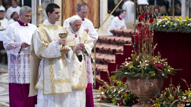 Pope Benedict XVI prepares to offer the communion as he celebrates a mass in St. Peter's Basilica at the Vatican, January 1, 2013.