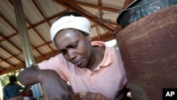 Rev. Appolonia Okwu of Nigeria built a fire in her hand-built mud and straw brick oven, and efficient, clean-burning alternative to open fires that lead to 1.6 million deaths annually in the world's poorest countries.