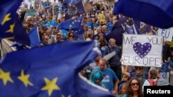 """FILE - Pro-Europe demonstrators protest during a """"March for Europe"""" against the Brexit vote result earlier in the year, in London, Sept. 3, 2016."""