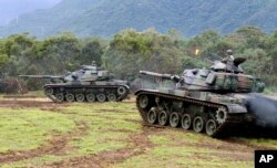 FILE - Tanks are seen during military exercises in Hualien, eastern Taiwan, Jan. 30, 2018.