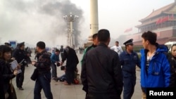 Smoke rises near the main entrance of the Forbidden City at Tiananmen Square in Beijing Oct. 28, 2013,after a car plowed into pedestrians and caught fire, killing five.