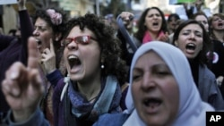 Egyptian women chant anti-military ruling council slogans during a demonstration outside the Journalist's Syndicate in Cairo, to mark International Women's Day, March 8, 2012.