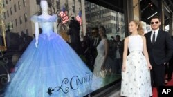 "The stars of Disney's film ""Cinderella,"" Lily James and Richard Madden, unveil themed store windows at Saks Fifth Avenue in New York, March 9, 2015."