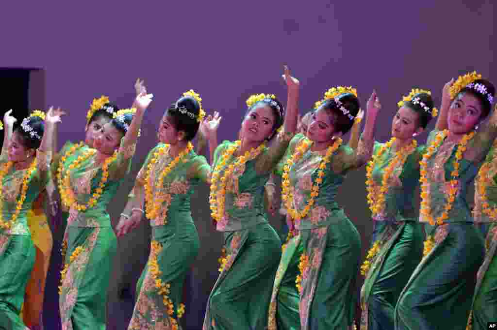 Performers take part in a traditional dance during a ceremony to mark the Myanmar Water Festival at the Presidential Palace in Naypyitaw, to mark the New Year according to the traditional lunar calendar.