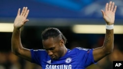Chelsea's Didier Drogba celebrates after scoring during the Champions League Group G soccer match between Chelsea and NK Maribor at Stamford Bridge stadium in London Tuesday, Oct. 21, 2014.