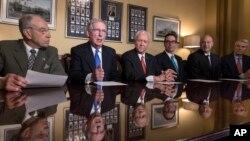 Senate Judiciary Committee Chairman Chuck Grassley, R-Iowa, Senate Majority Leader Mitch McConnell, R-Ky., Senate Finance Committee Chairman Orrin Hatch, R-Utah, talk to reporters in Washington, Nov. 9, 2017.