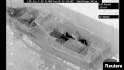 Аэрофотоснимок, полученный с помощью инфракрасной камеры, подтвердил местонахождение Джохара Царнаева в лодке. Уотретаун, Бостон. 19 апреля 2013 года