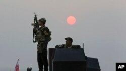 Pasukan elit Irak siap bergerak ke Mosul dari desa Tob Zawa, untuk merebut kembali kota tersebut dari tangan ISIS (24/10).