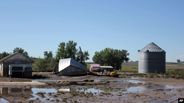 Farm buildings in Johnstown, Colorado, are damaged following this past week's floods, Sept. 17, 2013.