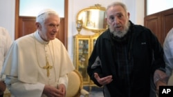 In this picture made available by the Vatican newspaper Osservatore Romano, Pope Benedict XVI meets with Fidel Castro in Havana, Cuba, Wednesday, March 28, 2012.