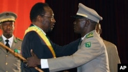 Mali's Interim President Dioncounda Traore, left, was congratulated by coup leader Amadou Sanogo after being first sworn in at a ceremony in Bamako, Mali, April 12, 2012.