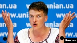 Ukrainian pilot and MP Nadiya Savchenko attends a news conference in Kyiv, August 2, 2016.