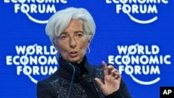 "FILE - Managing Director of the International Monetary Fund, Christine Lagarde, speaks during a panel ""The Global Economic Outlook"" at the World Economic Forum in Davos, Switzerland, Jan. 23, 2016."