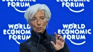 """FILE - Managing Director of the International Monetary Fund, Christine Lagarde,  speaks during a panel """"The Global Economic Outlook"""" at the World Economic Forum in Davos, Switzerland, Jan. 23, 2016. Lagarde, has warned Ukraine it would be unable to keep supporting it financially if the country doesn't step up its reforms efforts."""