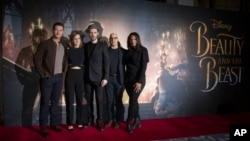 Actors from left, Luke Evans, Emma Watson, Dan Stevens, Stanley Tucci and Audra McDonald pose for photographers during a photo call for the Beauty And The Beast Premiere, in London, Feb. 24, 2017.