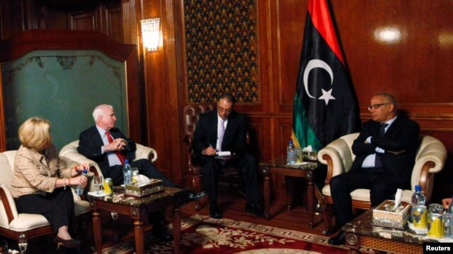 Libyan Prime Minister Ali Zeidan (R) meets with U.S. Senator John McCain (2nd L) at the headquarters of the Prime Minister's Office in Tripoli, December 4, 2013.