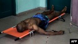 L'activiste des mouvements citoyens, Rossy Mukendi Tshimanga, blessé par balle lors d'une manifestation à Kinshasa, le 25 février 2018.