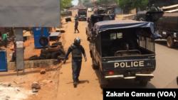 Des policiers et des manifestants lors d'une manifestation à Conakry, en Guinée, le 22 mars 2018. (VOA/Zakaria Camara)
