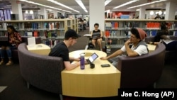 FILE - Students study for their exams at the Cal State Northridge campus in Los Angeles on Thursday, May 12, 2016. The largest university system in the United States, announced that it will move all fall season classes online because of the coronavirus. (AP Photo/Jae C. Hong)