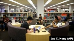 Students Sean Aitchison, left, and Alex Aguilar study for their final exams at the newly-renovated Oviatt Library on the Cal State Northridge campus in Los Angeles on Thursday, May 12, 2016. The facility underwent a five-year renovation that included flex