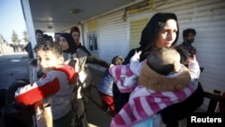 Syrians refugees in Turkey who have fled violence in their home country. A U.N. investigation has accused the Syrian government of carrying out what amount to war crimes against civilian detainees.