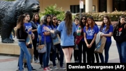 A bioengineering student leads prospective college-bound high school seniors on a campus tour in Los Angeles. Fewer California high school students have been offered admission to University of California campuses for the fall, officials reported