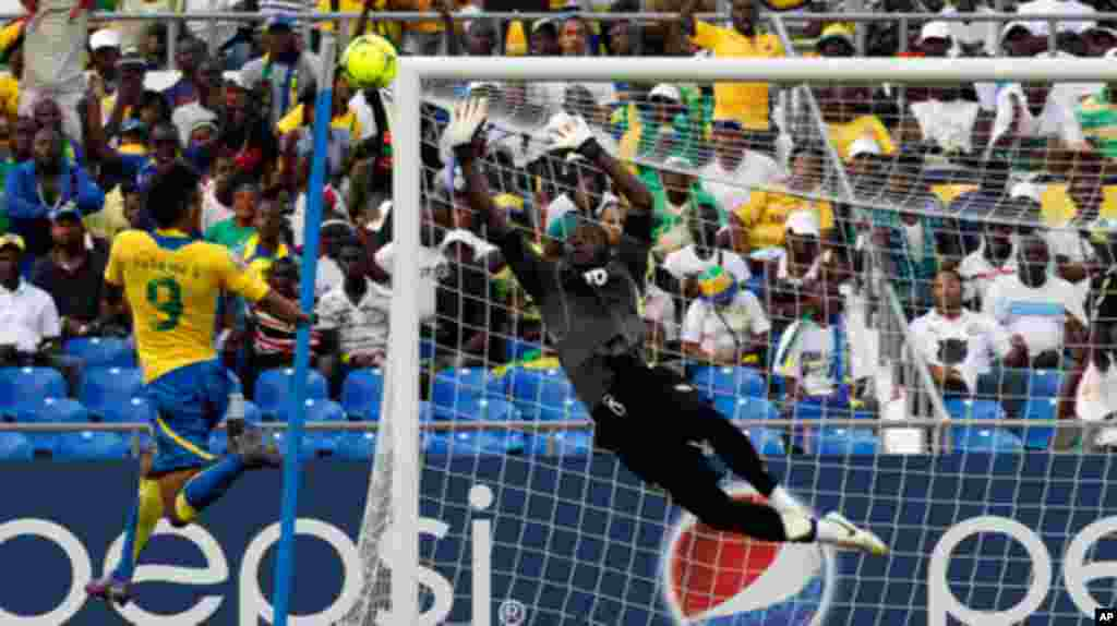 Gabon's Emerick scores past Niger's Saminou during their African Cup of Nations soccer match in Libreville