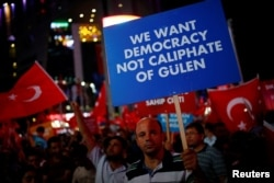 FILE - Banners and flags are waved at a solidarity rally nearly two weeks after a failed attempted coup in Ankara, Turkey, July 27, 2016.