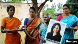 Women gather to celebrate the victory of Kamala Harris in Painganadu near the village of Thulasendrapuram, where Harris' maternal grandfather was born and grew up, in the southern state of Tamil Nadu, India, Nov. 8, 2020.