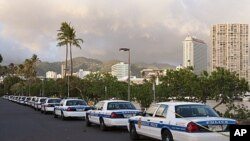 Honolulu police cars line the parking lot of Ala Moana Beach Park, Nov. 8, 2011 in Honolulu.