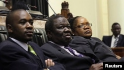 Zimbabwe VP Joice Mujuru (R), Prime Minister Morgan Tsvangirai (C) and member of the House of Assembly of Zimbabwe for Kuwadzana Nelson Chamisa attends the presentation of the Final Draft of the Constitution in Harare, February 6, 2013.
