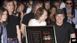 FILE - AC/DC (with Malcolm Young) Inducted into The Hollywood Rock Walk Guitar Center in Hollywood, CA.