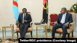 Perezida wa Kongo Joseph Kabila (Ibubamfu) na perezida, Joao Manuel Gonçalves Lourenço wa l'Angola, i buryo mu nama i Kinshasa, RDC, itariki 14/02/2018.