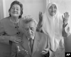 "The Jewish family that lived with the Kazazi family (pictured) escaped the Nazis during searches by scrambling through connecting doorways to other homes. ""Our parents were not very religious, but they believed in the Koran and Besa,"" the grown Kazazi chi"