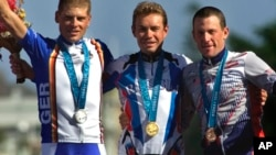 Russia's Viacheslav Ekimov, center, winner of the gold medal in the men's individual time trials, celebrates with Germany's silver medal winner Jan Ullrich, left, and U.S bronze medal winner Lance Armstrong at the cycling road course in Sydney, for the Summer Olympic Games, Sept. 30, 2000.