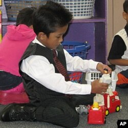 Families send their children to school in their best clothes, which doesn't stop them from playing