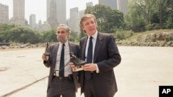 FILE - Donald Trump, right, poses with New York City's Park Commissioner Henry Stern holding a pair of ice skates that are intended for use at the Wollman Skating Rink Central Park in New York, Aug. 7, 1986.