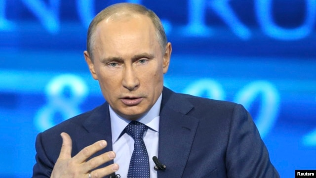 Russian President Vladimir Putin takes questions as part of a live broadcast in Moscow, April 25, 2013.