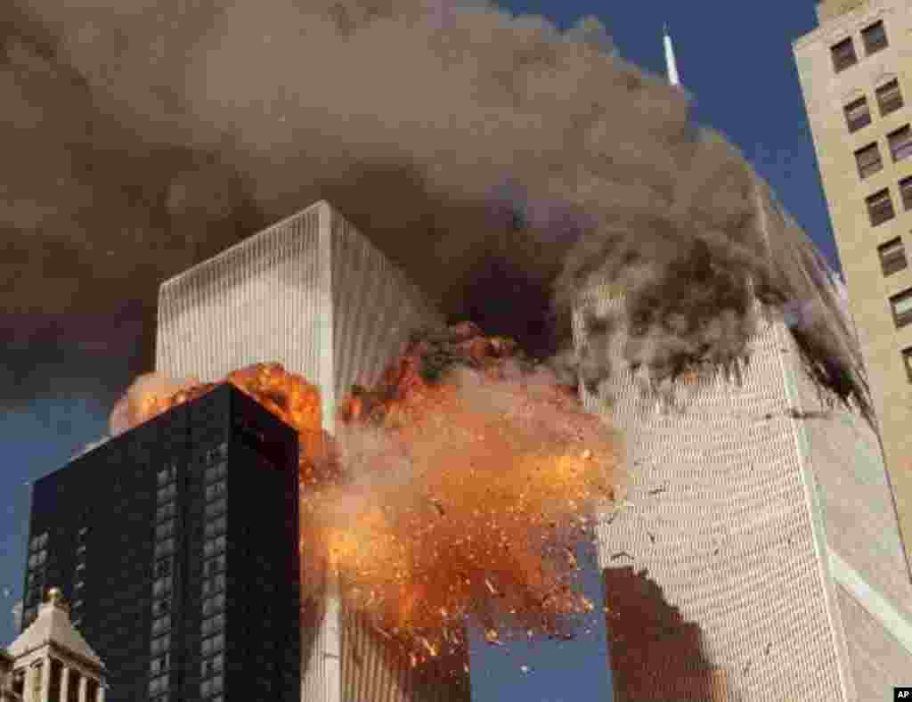 Smoke billows from one of the towers of the World Trade Center and flames and debris explode from the second tower, Tuesday, Sept. 11, 2001. In one of the most horrifying attacks ever against the United States, terrorists crashed two airliners into the Wo