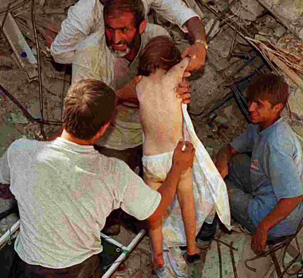 A four-year-old child is rescued from the rubble of the child's home after being trapped for 36 hours following an earthquake, Istanbul, August 19, 1999. (Reuters)