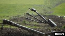 FILE - Armenian artillery is seen near Nagorno-Karabakh's boundary, April 8, 2016.