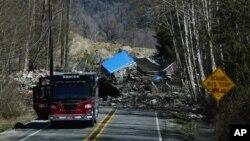 Một căn nhà bị chôn dưới bùn trên đường cao tốc 530 ở Oso, bang Washington, ngày 23/3/2014.