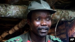 FILE - Joseph Kony, leader of the Lord's Resistance Army, meets with delegation of 160 officials, lawmakers from northern Uganda, in Congo near the Sudan border, July 31, 2006.