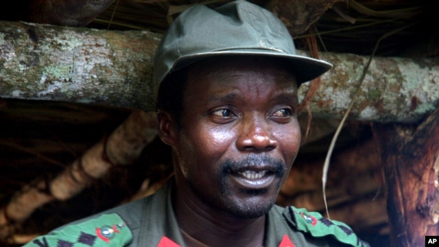 FILE - Joseph Kony, leader of the Lord's Resistance Army, is seen during a meeting with Ugandan officials and NGO representatives in Congo, near the Sudan border, July 31, 2006.