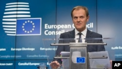 European Council President Donald Tusk speaks during a media conference after an EU summit in Brussels, Dec. 18, 2014.