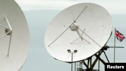 "FILE - Satellite dishes are seen at GCHQ's outpost at Bude, close to where trans-Atlantic fiber-optic cables come ashore in Cornwall, southwest England June 23, 2013. On Monday, with a simple ""Hello, world,"" the secretive agency joined the Twittersphere."