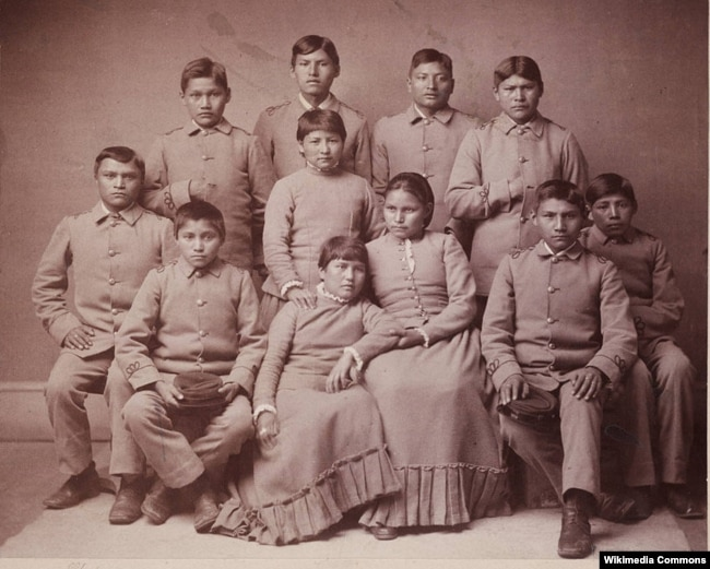 Photo portrait of Chiricahua Apache youths four months after arriving at the Carlisle Indian Industrial School in Carlisle, Pennsylvania.