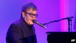 "Elton John performs at the 20th Annual Race to Erase MS Event ""Love to Erase MS"" at the Hyatt Regency Century Plaza on May 3, 2013 in Los Angeles."